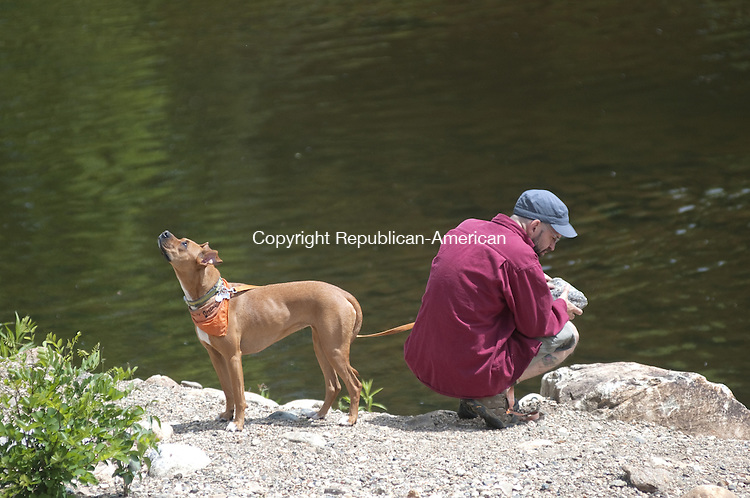 TORRINGTON, CT, 20  MAY 15 - A man and his dog spend time near the Naugatuck River in Torrington Thursday morning where eventually a trail will connect downtown to the planned 44-mile Naugatuck River Greenway that will stretch from Derby to Torrington.   Alec Johnson/ Republican-American