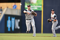 Toledo Mud Hens third baseman Mike Hessman #27 throws to first base during a game against the Durham Bulls at Durham Bulls Athletic Park on July 25, 2014 in Durham, North Carolina. The Mud Hens defeated the Bulls 5-3. (Tony Farlow/Four Seam Images)
