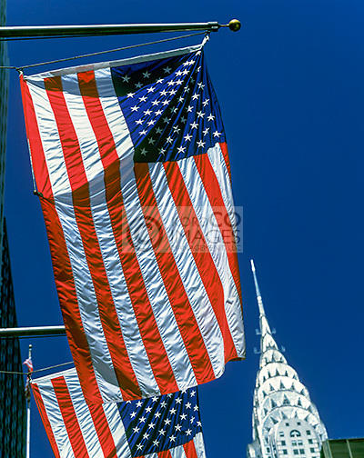 ROW OF UNITED STATES FLAGS FLYING ON FLAGPOLES FORTY SECOND STREET MANHATTAN NEW YORK CITY USA