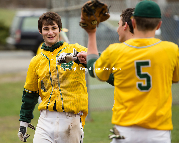 WATERBURY, CT- 06 April 2016-040616EC01-  Holy Cross' Adam Zullo gets congratulations from teammates after he scores against Kennedy High Wednesday at Waterville Park in Waterbury. Erin Covey Republican-American