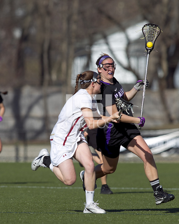 University at Albany midfielder Rachael Burek (9) advances the ball as Boston College midfielder Kate Collins (6) defends. University at Albany defeated Boston College, 11-10, at Newton Campus Field, on March 30, 2011.