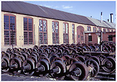 Wheel sets stored behind the D&amp;RGW Alamosa machine shop.<br /> D&amp;RGW  Alamosa, CO  Taken by West, John - 5/1968