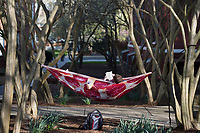 Jacob Reed, a junior chemical engineering major from Starkville, starts off Spring Break by relaxing in a hammock next to Mitchell Memorial Library. Although there are no classes this week, those in Starkville can attend Monday's NCAA Women's Basketball Tournament Selection Show watch party or Wednesday's men's NIT game between MSU and Nebraska. <br />