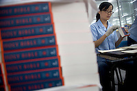 "Amity Printing Company employees sand the edges of newly-printed English Standard Version Holy Bibles in the Amity Printing Company's new printing facility in Nanjing, China....On May 18, 2008, the Amity Printing Company in Nanjing, Jiangsu Province, China, inaugurated its new printing facility in southern Nanjing.  The facility doubles the printing capacity of the company, now up to 12 million Bibles produced in a year, making Amity Printing Company the largest producer of Bibles in the world.  The company, in cooperation with the international organization the United Bible Societies, produces Bibles for both domestic Chinese use and international distribution.  The company's Bibles are printed in Chinese and many other languages.  Within China, the Bibles are distributed both to registered and unregistered Christians who worship in illegal ""house churches."""
