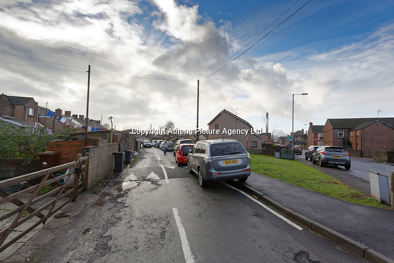 """Pictured: The lane leading to the garage where the latest Banksy graffiti is located is full of parked cars in Port Talbot, Wales, UK. Thursday 20 December 2018<br /> Re: The artist Banksy has confirmed that a new graffiti piece that has appeared in Port Talbot, south Wales is his.<br /> He announced on Instagram: """"Season's greetings"""" - with a video of the artwork in the Taibach area of Port Talbot.<br /> The image appears on two sides of a garage in a lane near Caradog Street, depicting a child enjoying snow falling - the other side reveals it is a fire emitting ash.<br /> The owner of the garage said he had not slept over fears it might be vandalised."""