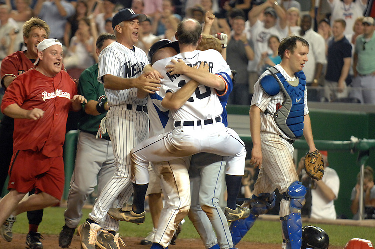 The Republican team swarms Rep. Adam Putnam, R-Fla., after he scored the winning run at the annual Congressional Baseball, won by the Republicans, July 17, 2008.