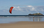 Kiteboarding at low tide on the beach at Godrevy, Cornwall