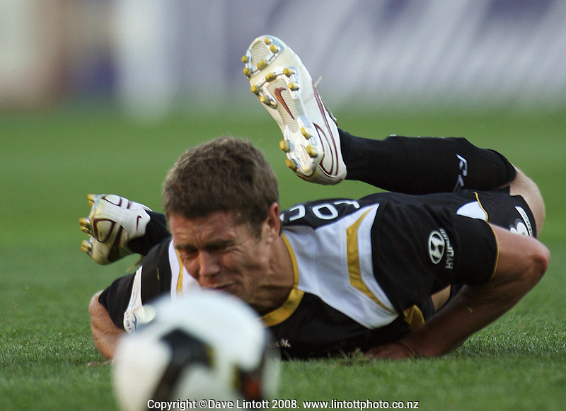 Tony Lochhead crashes to the turf after being fouled during the A-League football match between the Wellington Phoenix and Perth Glory at Westpac Stadium, Wellington, New Zealand on Saturday, 13 December 2008. Photo: Dave Lintott / lintottphoto.co.nz