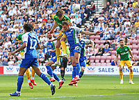 Preston North End's Ben Davies beats Wigan Athletic's Kal Naismith to head towards goal<br /> <br /> Photographer David Shipman/CameraSport<br /> <br /> The EFL Sky Bet Championship - Wigan Athletic v Preston North End - Monday 22nd April 2019 - DW Stadium - Wigan<br /> <br /> World Copyright © 2019 CameraSport. All rights reserved. 43 Linden Ave. Countesthorpe. Leicester. England. LE8 5PG - Tel: +44 (0) 116 277 4147 - admin@camerasport.com - www.camerasport.com