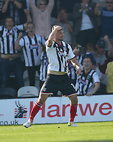 Grimsby Town's Padraig Amond scores with a header to level the scores at 2-2