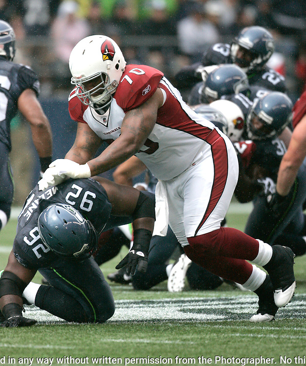 Arizona Cardinals guard Rex Hadnot pushes Seattle Seahawks defensive tackle Brandon Melbane to the turf at CenturyLink Field in Seattle, Washington September 25, 2011.  The Seahawks beat the Cardinals 13-10.  ©2011 Jim Bryant Photo. All Rights Reserved.