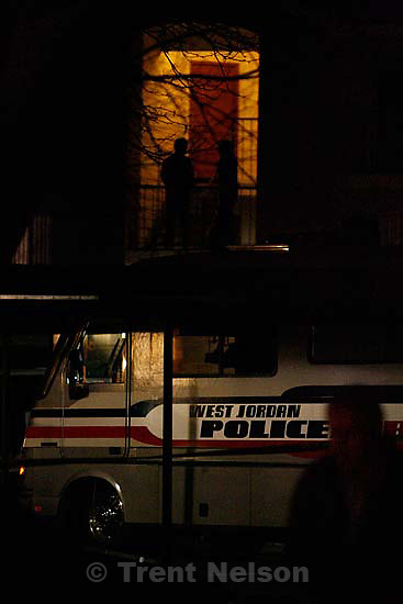 Police investigators at the scene on an apparent murder-suicide at the Willow Cove apartments in West Jordan, Thursday, December 17, 2009.