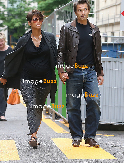 Halle Berry ( pregnant ) and Olivier Martinez are seen strolling on the 'Avenue Montaigne' on June 11, 2013 in Paris, France.
