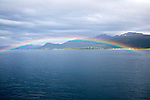 Rainbow over sea near Stokmarknes, Hadsel municipality, Hadseloya island, Nordland, Vesteralen region, northern Norway