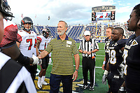 24 September 2011:  FIU's and ULL's captains, together with honorary captain Ralph Gazitua (center), meet at midfield for the coin toss prior to the game.  The University of Louisiana-Lafayette Ragin Cajuns defeated the FIU Golden Panthers, 36-31, at FIU Stadium in Miami, Florida.