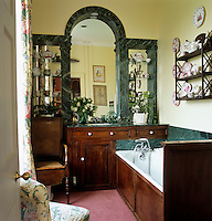 A collection of Sunderland lustreware is displayed in the bathroom