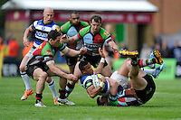 Anthony Watson of Bath Rugby is tackled by Tim Molenaar of Harlequins as Tom Williams (left) and Nick Evans of Harlequins support during the Aviva Premiership match between Harlequins and Bath Rugby at The Twickenham Stoop on Saturday 10th May 2014 (Photo by Rob Munro)