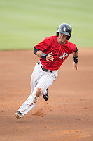 Eddy Alvarez (1) of the Kannapolis Intimidators hustles towards third base against the Greensboro Grasshoppers at CMC-Northeast Stadium on June 9, 2015 in Kannapolis, North Carolina.  The Intimidators defeated the Grasshoppers 6-4.  (Brian Westerholt/Four Seam Images)
