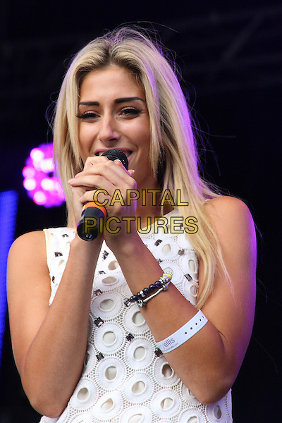 STACEY SOLOMON .Summer Live Music Festival at Sandown Park, nr Esher, Surrey, England..August 28th, 2010.stage concert live gig performance music half length white dress circles singing = sleeveless.CAP/JIL.©Jill Mayhew/Capital Pictures