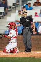 Home plate umpire Kaz Endo hands a new baseball to Johnson City Cardinals catcher Chris Rivera (12) during the game against the Bristol Pirates at Howard Johnson Field at Cardinal Park on July 6, 2015 in Johnson City, Tennessee.  The Pirates defeated the Cardinals 2-0 in game one of a double-header. (Brian Westerholt/Four Seam Images)