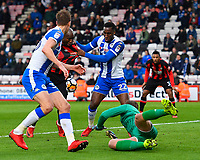 Benik Afobe of AFC Bournemouth is grabbed by Cheyenne Dunkley of Wigan Athletic during AFC Bournemouth vs Wigan Athletic, Emirates FA Cup Football at the Vitality Stadium on 6th January 2018