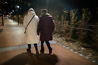 Switzerland. Canton Ticino. Lugano. Two elderly women walk at night during a cold evening. 5.01.2020  © 2020 Didier Ruef