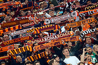 roma's supporters hold up the scarf during the Champions League Group E soccer match between As Roma and  Bayer Leverkusen at the Olympic Stadium in Rome, November 04 2015