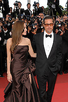ANGELINA JOLIE &amp; BRAD PITT<br /> 'The Tree of Life' premiere at the Palais des Festival, 64th International Cannes Film Festival, France<br /> 16th May 2011<br /> half 3/4 length strapless silk satin brown dress gown black tux tuxedo tinted glasses sunglasses shades couple gathered goatee facial hair photographers press profile<br /> CAP/PL<br /> &copy;Phil Loftus/Capital Pictures /MediaPunch ***NORTH AND SOUTH AMERICAS ONLY***