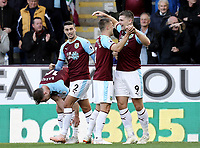 Burnley's Sam Vokes (right) celebrates scoring the opening goal with team-mate Johann Gudmundsson<br /> <br /> Photographer Rich Linley/CameraSport<br /> <br /> The Premier League - Burnley v Huddersfield Town - Saturday 6th October 2018 - Turf Moor - Burnley<br /> <br /> World Copyright &copy; 2018 CameraSport. All rights reserved. 43 Linden Ave. Countesthorpe. Leicester. England. LE8 5PG - Tel: +44 (0) 116 277 4147 - admin@camerasport.com - www.camerasport.com