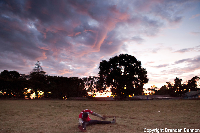 An athlete warms up before running sprints at a track in Iten, Kenya. High altitude training and a deep pool of talent make Iten the running capital of Kenya.