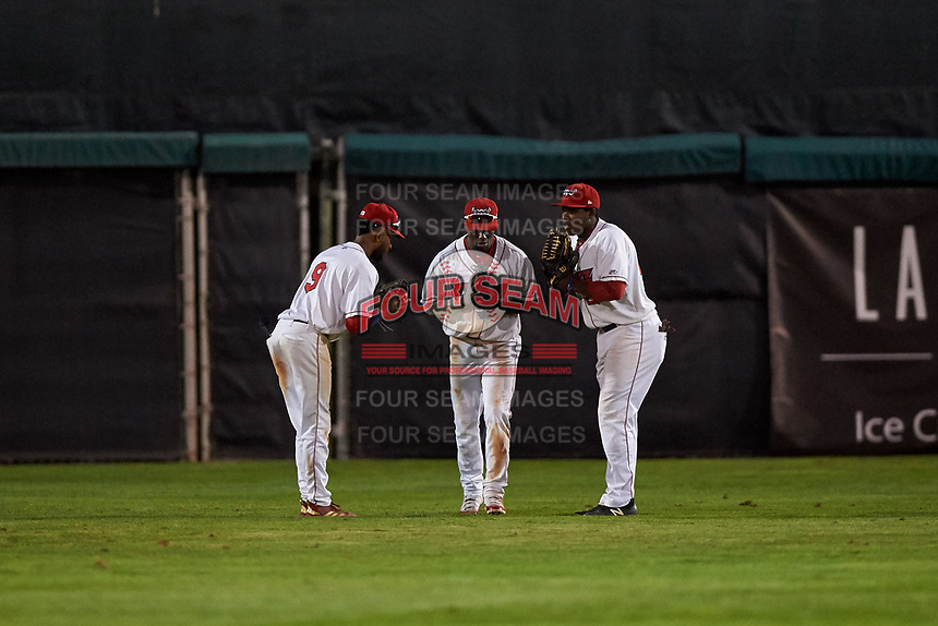 Orem Owlz outfielders Brandon White (9), D'Shawn Knowles (32), and Johan Sala (27) celebrate a victory after a Pioneer League game against the Idaho Falls Chukars at The Home of the OWLZ on August 13, 2019 in Orem, Utah. Orem defeated Idaho Falls 3-1. (Zachary Lucy/Four Seam Images)