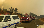 August 20, 2001 Coulterville, California  -- Creek Fire –  Strike team of fire engines moves along Priest-Coulterville Road.  The Creek Fire burned 11,500 acres between Highway 49 and Priest-Coulterville Road a few miles north of Coulterville, California.