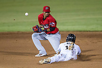 San Antonio Missions outfielder Rico Noel (17) slides head-first into second base during the Texas League baseball game as Frisco Roughriders shortstop Luis Sardinas (2) bobbles for the ball on August 22, 2013 at the Nelson Wolff Stadium in San Antonio, Texas. Frisco defeated San Antonio 2-1. (Andrew Woolley/Four Seam Images)