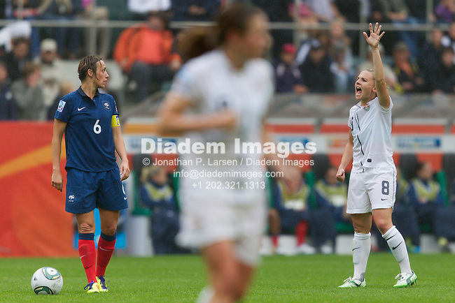 MOENCHENGLADBACH, GERMANY - JULY 13:  Amy Rodriguez of the United States (R) gestures as France team captain Sandrine Soubeyrand (L) looks on during a FIFA Women's World Cup semifinal match at Stadion im Borussia Park on July 13, 2011  in Moenchengladbach, Germany.  Editorial use only.  Commercial use prohibited.  No push to mobile device usage.  (Photograph by Jonathan P. Larsen)