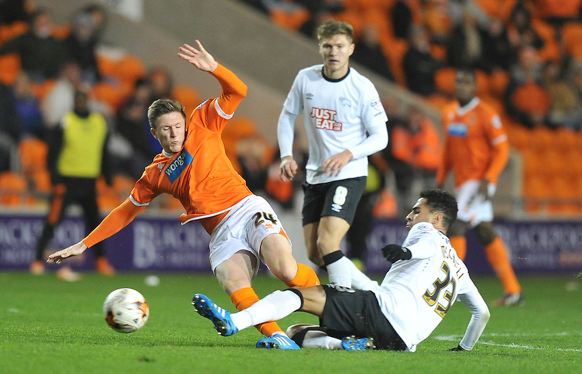 Blackpool's John Lundstram is tackled by Derby County's Omar Mascarell<br /> <br /> Photographer Dave Howarth/CameraSport<br /> <br /> Football - The Football League Sky Bet Championship - Blackpool v Derby County - Tuesday 21st October 2014 - Bloomfield Road - Blackpool<br /> <br /> &copy; CameraSport - 43 Linden Ave. Countesthorpe. Leicester. England. LE8 5PG - Tel: +44 (0) 116 277 4147 - admin@camerasport.com - www.camerasport.com