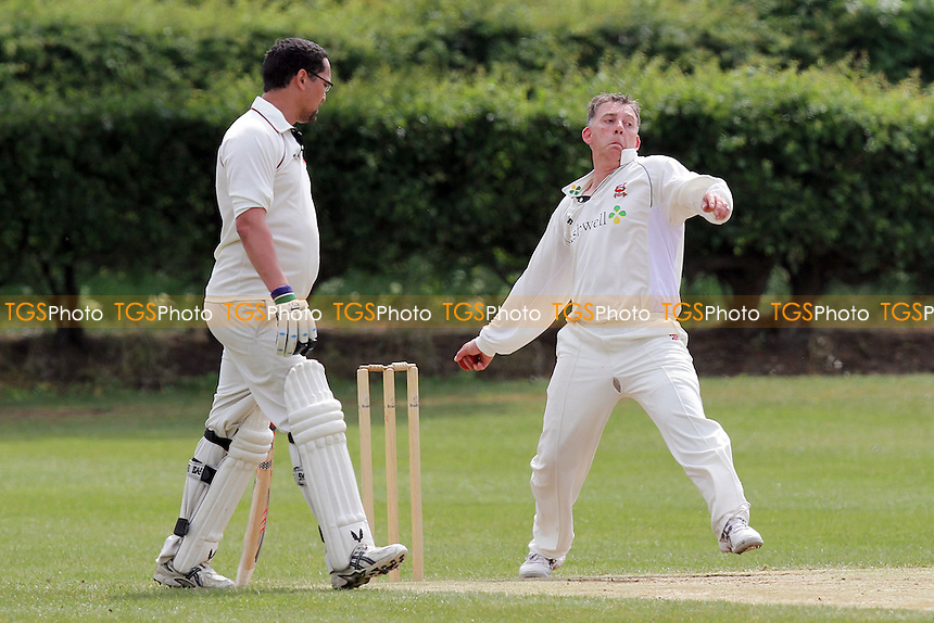 L French in bowling action for Noak Hill - Bishops Challoner CC (batting) vs Noak Hill Taverners CC - Essex Cricket League at the London Marathon Playing Fields - 07/05/11 - MANDATORY CREDIT: Gavin Ellis/TGSPHOTO - Self billing applies where appropriate - Tel: 0845 094 6026