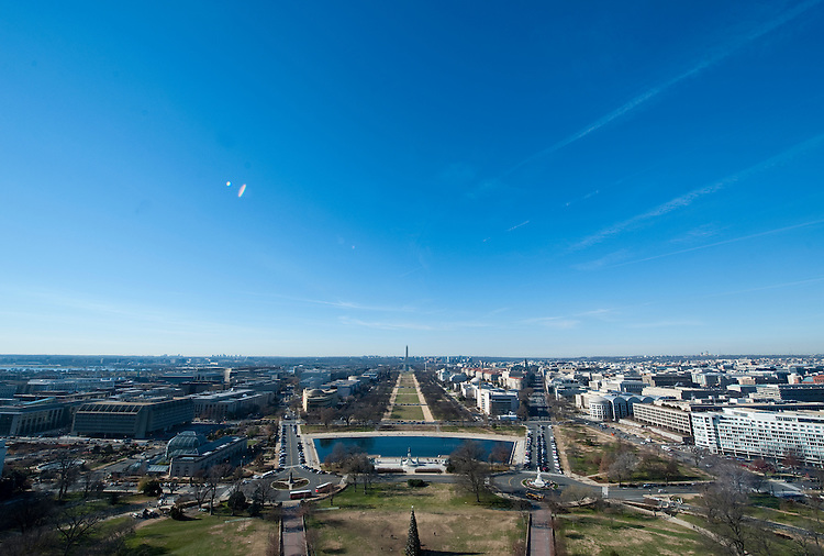 UNITED STATES - Dec 19: A view West from the top of the US Capitol dome during a tour of the dome December 19, 2013 in Washington, DC. The Dome has not undergone a complete restoration since 1959-1960 and due to age and weather is now plagued by more than 1,000 cracks and deficiencies. The Architect of the Capitol began in November, a multi-year project to repair these deficiencies, restoring the Dome to its original, inspiring splendor.  (Photo By Douglas Graham/CQ Roll Call)