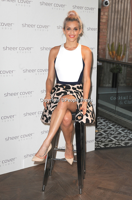Ashley Roberts attends photocall to mark being appointed the face of mineral makeup range Sheer Cover Studio at Forge, London on July 29th 2014<br /> <br /> Photo by People Press