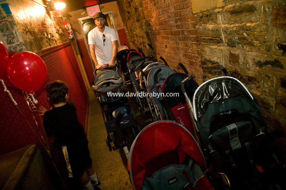 A man lines up strollers in the basement during a Baby Loves Disco event at Southpaw nightclub in the Park Slope neighborhood of Brooklyn in New York City, USA, 6 October 2007. In two years, Baby Loves Disco, a midday soiree specifically for the Mommy-and-me set, has become a nationwide phenomenon. One afternoon each month, local organizers take over a nightclub, complete with a cash bar and DJ and throw open the doors to anyone under the age of 7, accompanied by parents.