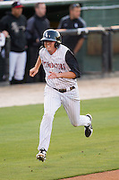 Zachary Voight (8) of the Kannapolis Intimidators hustles towards home plate against the Hickory Crawdads at CMC-Northeast Stadium on May 18, 2014 in Kannapolis, North Carolina.  The Intimidators defeated the Crawdads 6-5 in 10 innings.  (Brian Westerholt/Four Seam Images)