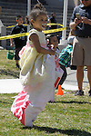 Amethyst Olivas, 4, runs in a sack race at the 7th Annual Easter Fiesta at Western Nevada College Saturday, March 26, 2016. The event, hosted by the Association of Latin American Students, had 3 separate egg hunts, face painting, limbo, musical chairs, ring toss, sack races, bowling,  food, music and a piñata.  <br />