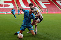 Kieran Dowell of Sheffield United and Jack Taylor of Barnet during Sheffield United vs Barnet, Emirates FA Cup Football at Bramall Lane on 6th January 2019