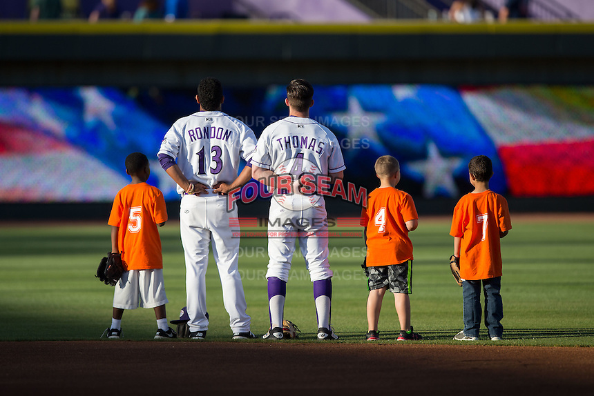 Cleuluis Rondon (13) and Toby Thomas (4) of the Winston-Salem Dash are joined on the field for the National Anthem by some youth baseball players prior to the game against the Potomac Nationals at BB&T Ballpark on May 13, 2016 in Winston-Salem, North Carolina.  The Dash defeated the Nationals 5-4 in 11 innings.  (Brian Westerholt/Four Seam Images)