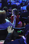 A mother and child sit in the audience before the Ford press presentation at the Detroit Auto Show in Detroit, Michigan on January 11, 2009.