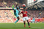West Ham's Michail Antonio beats Anthony Martial of Manchester United to a high ball during the Emirates FA Cup match at Old Trafford. Photo credit should read: Philip Oldham/Sportimage