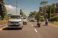 Bali, Indonesia.  Highway Traffic between Denpasar and Semarapura.