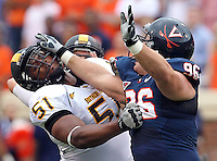 Virginia Cavaliers defensive tackle Nick Jenkins (96) defends Southern Miss Golden Eagles offensive linesman Darius Barnes (51) during the game at Scott Stadium. Virginia lost to Southern Mississippi 30-24. (Photo/Andrew Shurtleff)