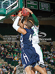 North Texas Mean Green forward Kedrick Hogans (24) and Jackson State Tigers center Raymond Gregory (44) in action during the game between the Jackson State Tigers and the University of North Texas Mean Green at the North Texas Coliseum,the Super Pit, in Denton, Texas. UNT defeated Jackson State 69 to 55...