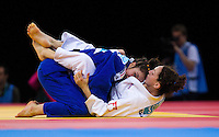 04 DEC 2011 - LONDON, GBR - Laura Vargas Koch (GER) (in blue) glances towards the clock during her semi final contest with Sally Conway (GBR) (in white) at the London International Judo Invitational and 2012 Olympic Games test event at the ExCel Exhibition Centre in London, Great Britain (PHOTO (C) NIGEL FARROW)