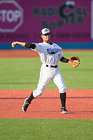 Hudson Valley Renegades third baseman Douglas Duran (10) warms up between innings of the game against the Brooklyn Cyclones at Dutchess Stadium on June 18, 2014 in Wappingers Falls, New York.  The Cyclones defeated the Renegades 4-3 in 10 innings.  (Brian Westerholt/Four Seam Images)